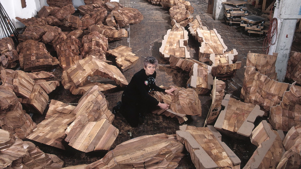 Von Rydingsvard in her Williamsburg studio on South 5th Street, surrounded by the cedar cast of katul katul, 2002.