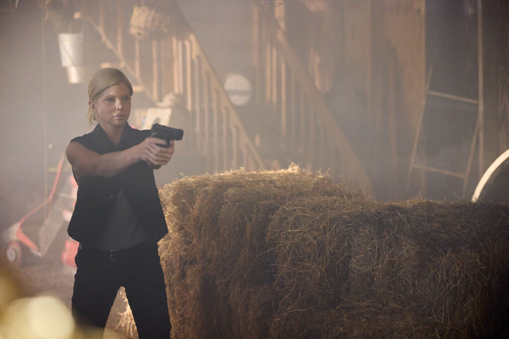 Donna D'Errico as Carly in the action film, SURVIVE THE GAME, a Lionsgate release. Photo courtesy of Lionsgat