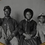 An unidentified African American soldier in a Union uniform with wife and two daughters as seen in Civil War (or, Who Do We Think We Are) , directed by Rachel Boyton. Image courtesy of the U.S. Library of Cong