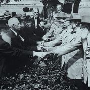 Union and Confederate veterans shaking hands at reunion to commemorate the 50th anniversary of the battle of Gettysburg as seen in Civil War (or, Who Do We Think We Are) , directed by Rachel Boyton. Image courtesy of the U.S. Library of Congress.
